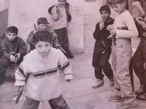 Children playing with toy guns celebrating Eid Al Fitr in Arwad, Syria.