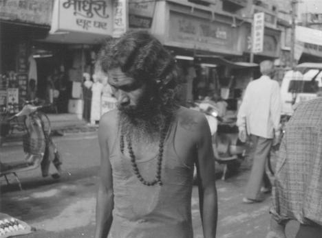 Sadhu walking along a street in Banaras, India