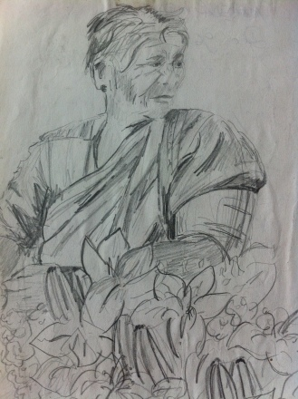 Woman selling flowers in Anjuna market, Goa from my India Sketchbook.