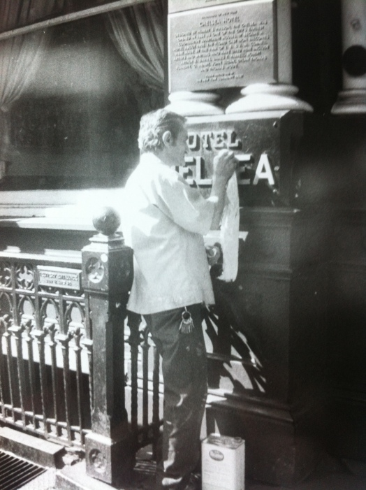 Getting ready for the day, polishing up the Chelsea Hotel sign in New York.