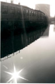 Industrial landscape reflected along the five weirs walk in Sheffield, England.
