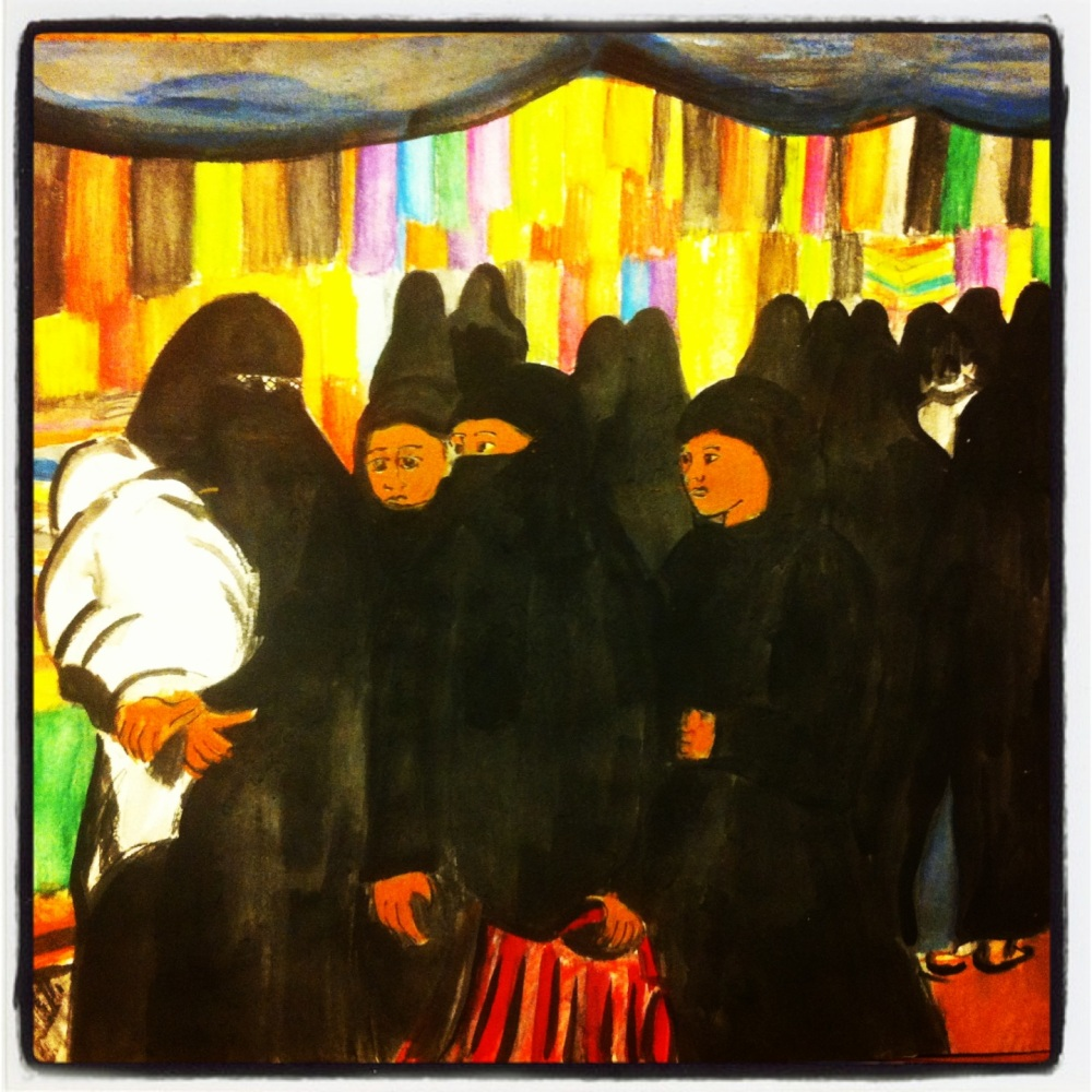 Women in burkas shopping in a cloth market in Hyderabad, Inda.