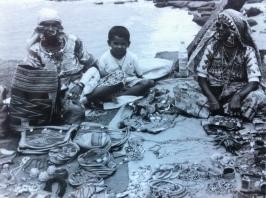 Women selling jewellery on Vagator Beach in Goa, India