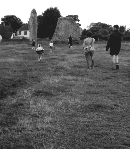 Running towards the ancient stones at the Stone Circle in Avebury, Wiltshire.