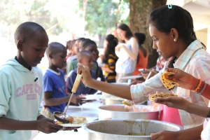 Serving up food at the Christmas Saturday School in Mwanza, Tanzania