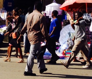 Street scene on Rwagasore Road outside the Central Market in Mwanza, Tanzania.