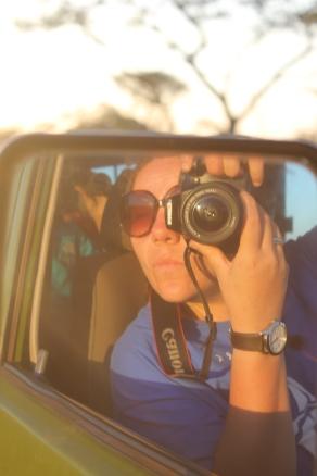 Wing-mirror selfie in the Safari Jeep