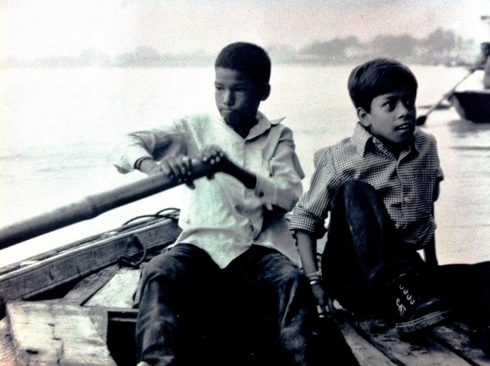 Rowing across the River Ganges in Vanarasi, India.