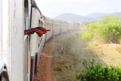 Children pointing through the window - On the train from Mwanza to Dar Es Salaam, Tanzania.