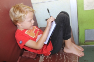 Leon writing his travel journal - On the train from Mwanza to Dar Es Salaam, Tanzania.