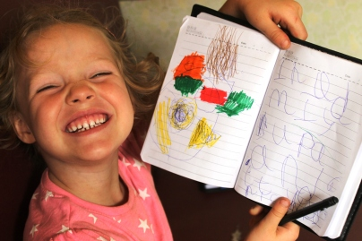 Frida drawing today's food in her travel journal - On the train from Mwanza to Dar Es Salaam, Tanzania.