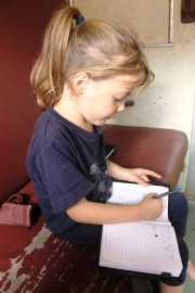 Lottie writing her travel journal - On the train from Mwanza to Dar Es Salaam, Tanzania.