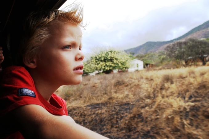 Leon looking at the Uluguru mountains - On the train from Mwanza to Dar Es Salaam, Tanzania.
