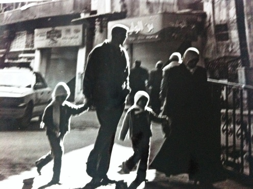 A family entering Umayyad Mosque in Damascus, Syria.