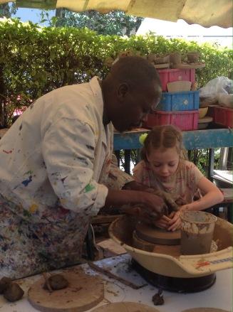 Lottie making a clay pot at Nairobi Art Centre