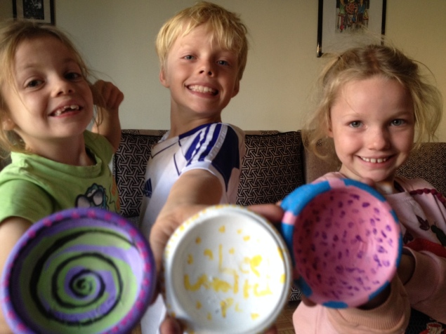 Lottie, Leon and Frida with their finished and painted clay pots