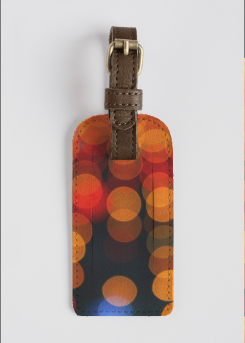 Blurred Orange Lights - leather accent tag