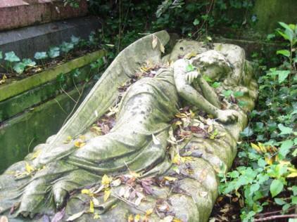 Sleeping Angel under ivy at Highgate Cemetery