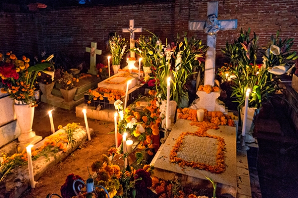 The old cemetery decorated for Day of the Dead festival known in spanish as Dia de Muertos at October 31, 2013 in Xoxocotlan, Mexico.